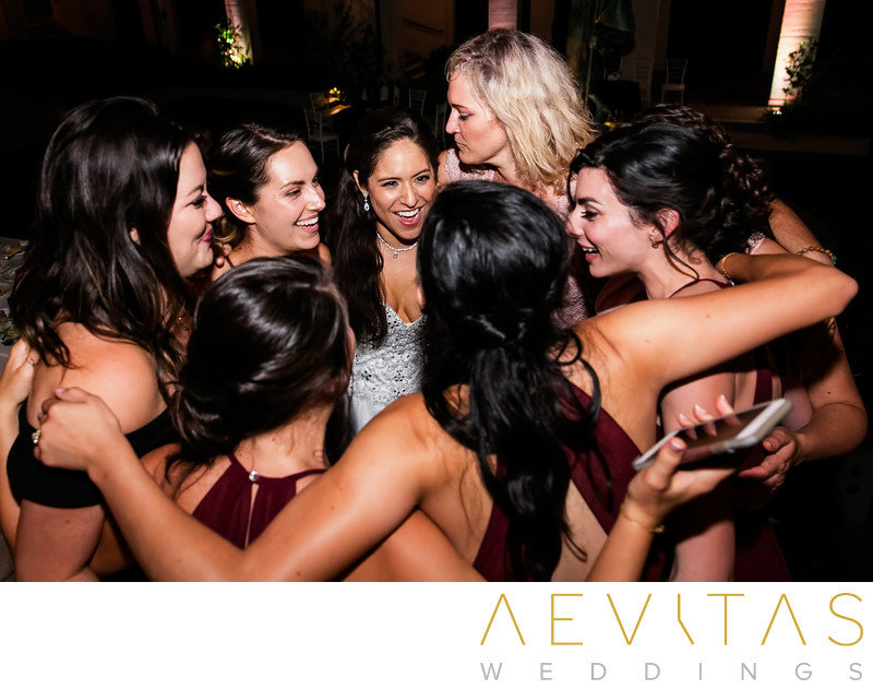 Bride with friends in huddle at The Ebell of LA wedding