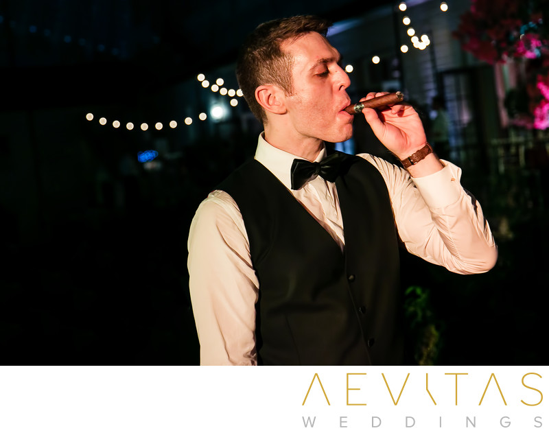 Groom smoking cigar at The Ebell of Los Angeles