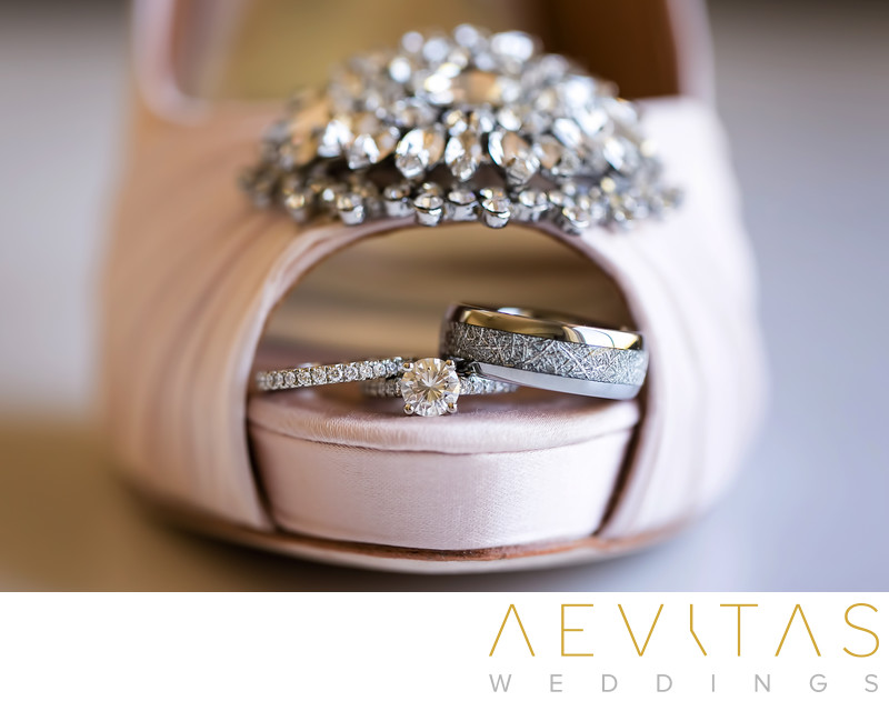 Close-up bride's shoes and rings at Oak Glen wedding