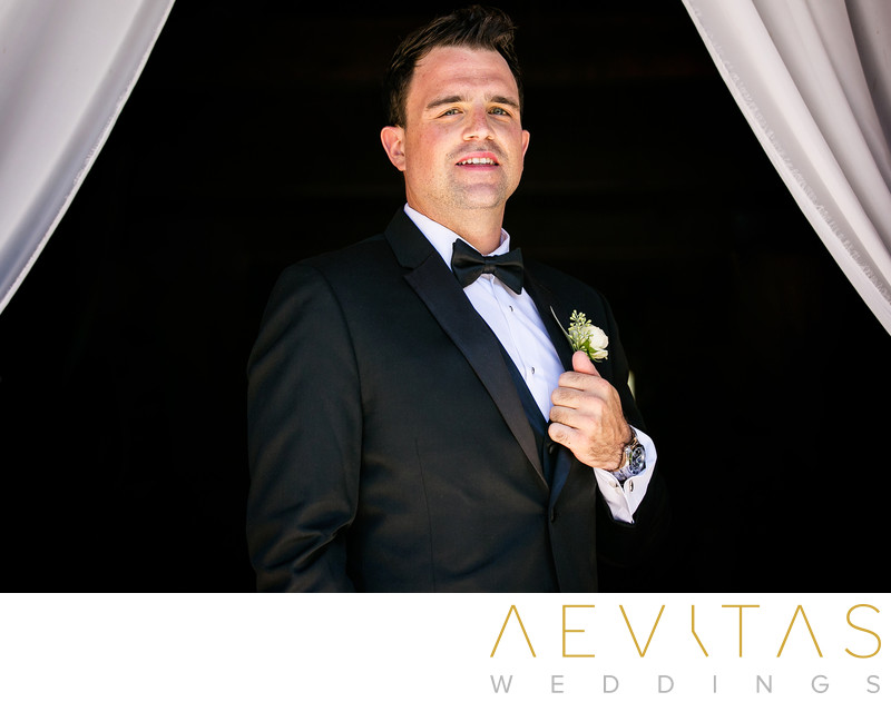 Sophisticated groom portrait with drapes in Oak Glen