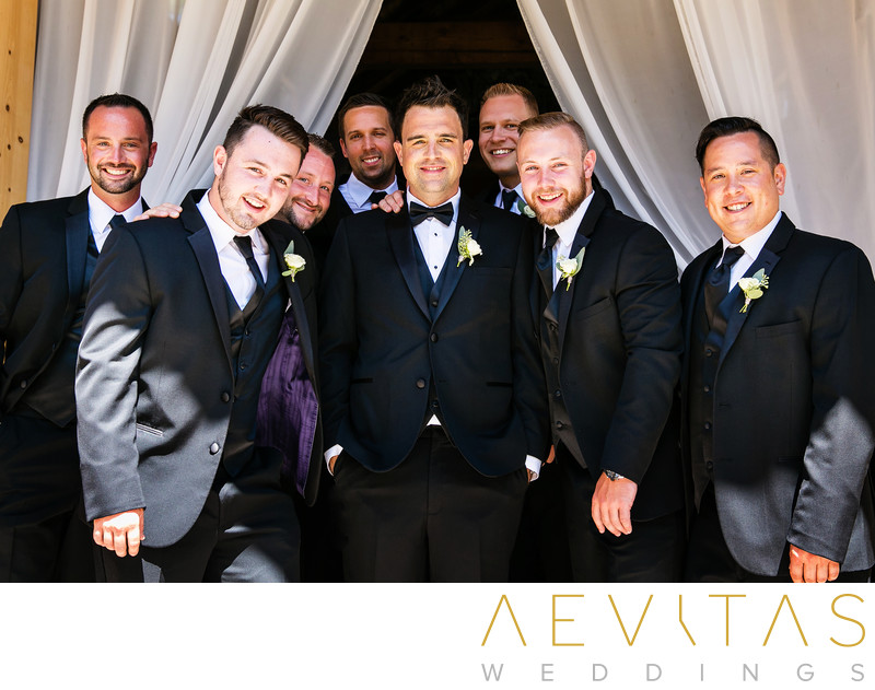 Groom with groomsmen portrait and drape frame