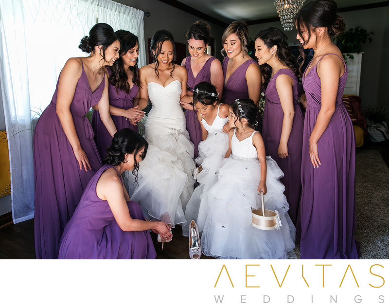 Bride stepping into shoes with bridesmaids Oak Glen