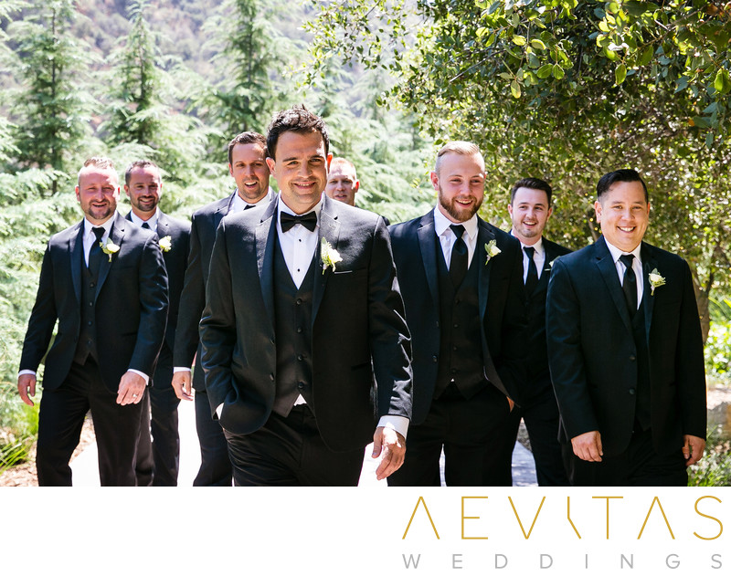 Casual groomsmen photo walking through Oak Glen gardens