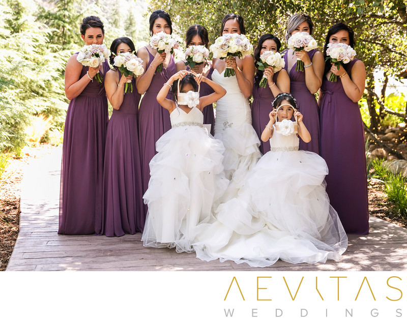 Playful bride and bridesmaids portrait Oak Glen wedding