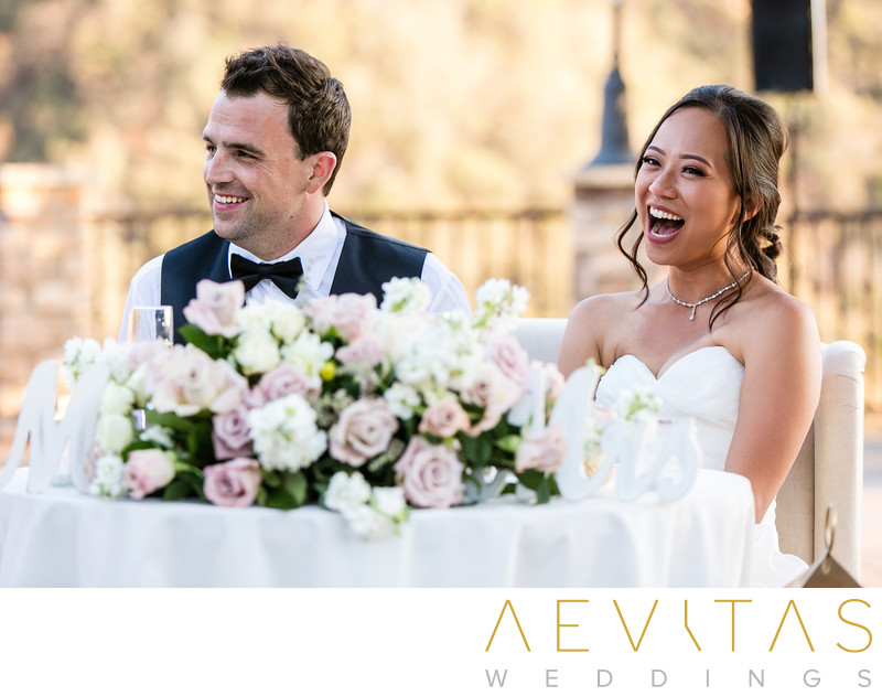 Couple laughing at sweetheart table Oak Glen wedding