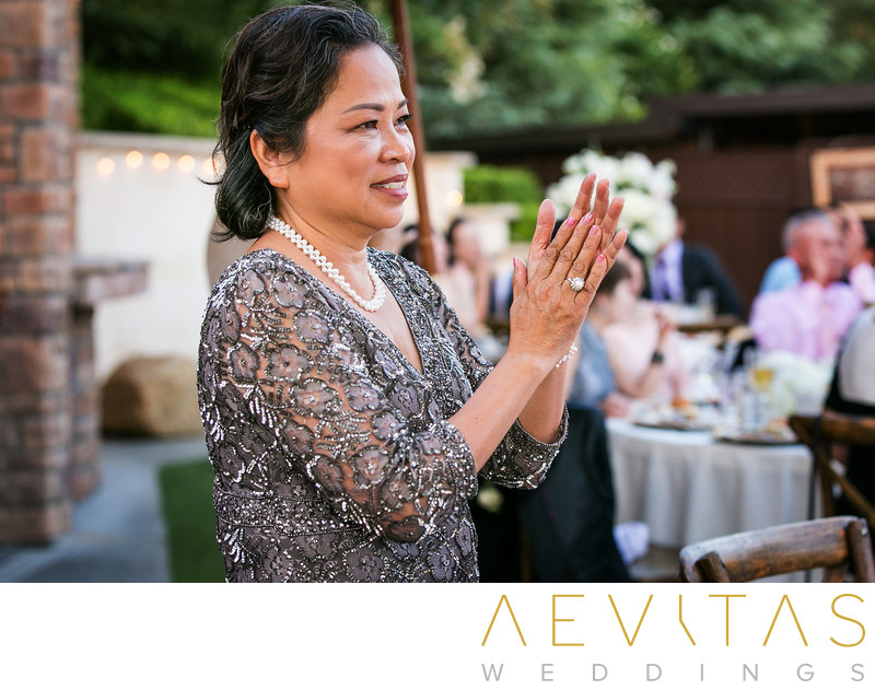 Mother-of-the-bride clapping at Oak Glen reception