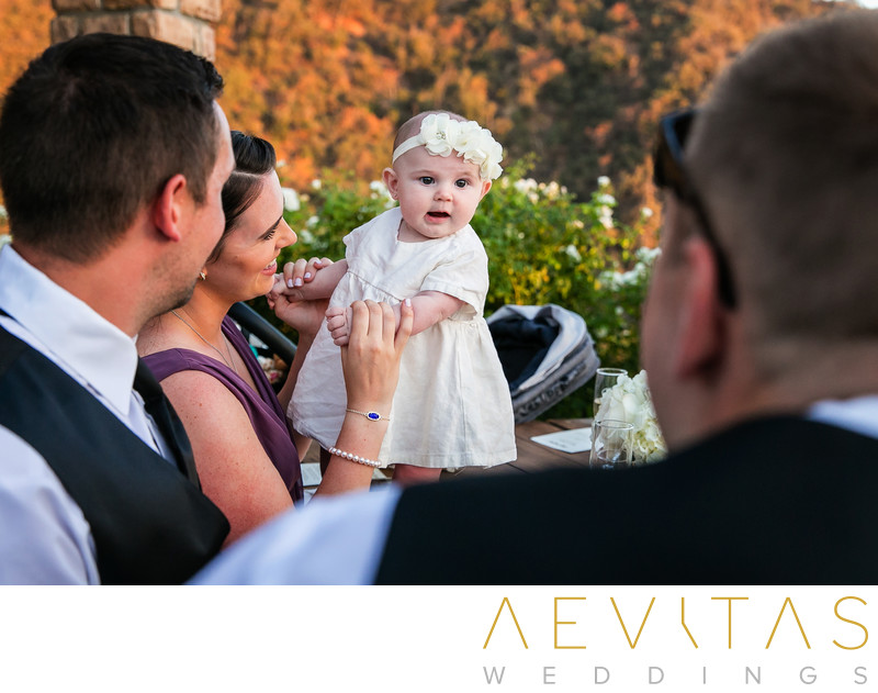 Cute baby wedding guest at Oak Glen reception