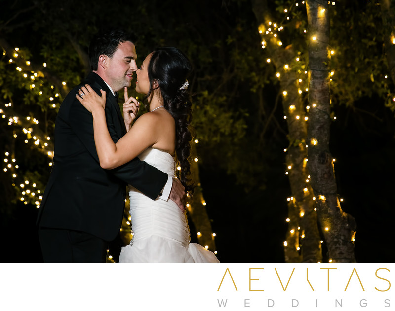 Couple dancing with string lights at Oak Glen wedding
