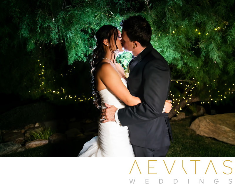 Couple kiss off-camera flash portrait in Oak Glen
