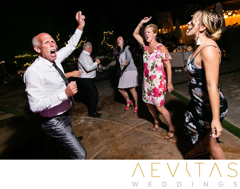 Wedding guests with arms in air at Oak Glen reception