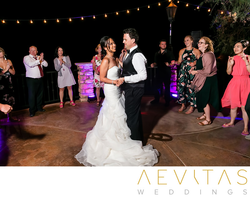 Couple dancing with guests Oak Glen wedding reception