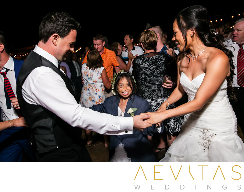 Couple dancing with flower girl at Oak Glen reception