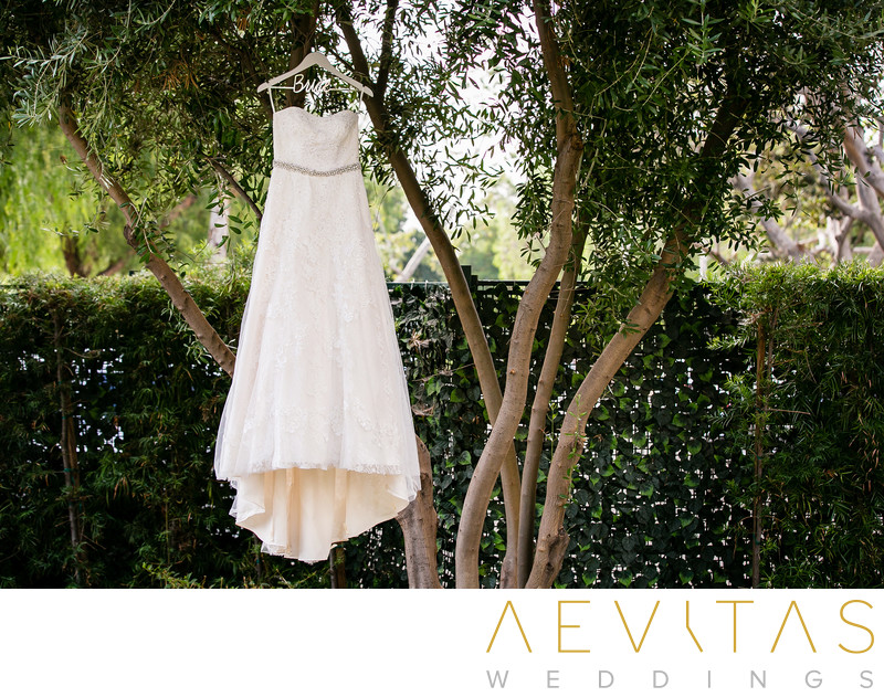 Wedding dress hanging in garden at Sheraton Fairplex