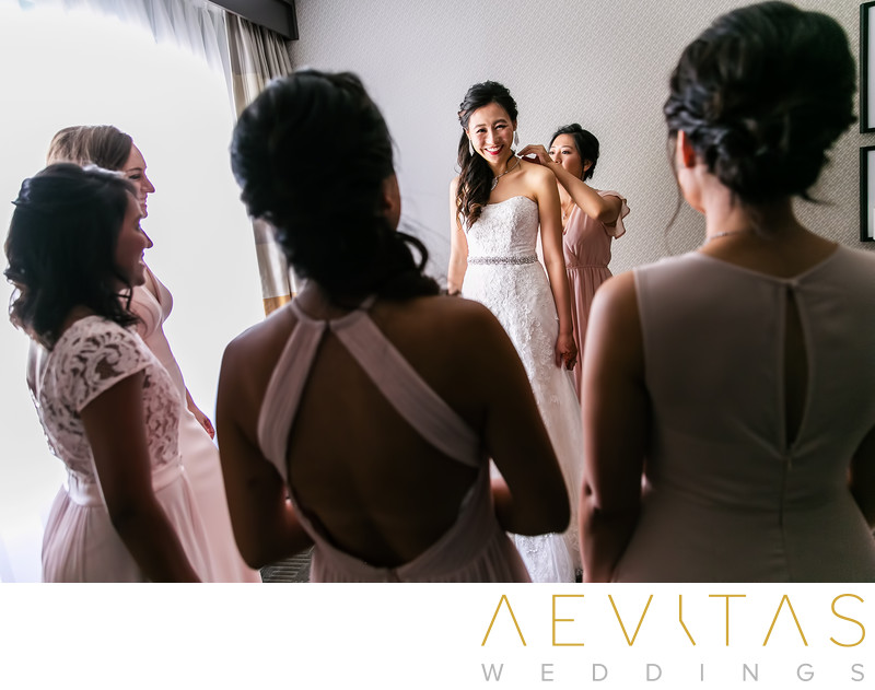 Creative bride getting ready photo with bridesmaids