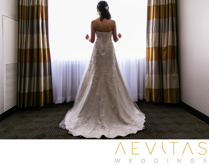 Bride portrait at Sheraton Fairplex Hotel suite window