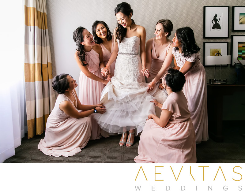 Bridesmaids surround bride in Pomona hotel suite