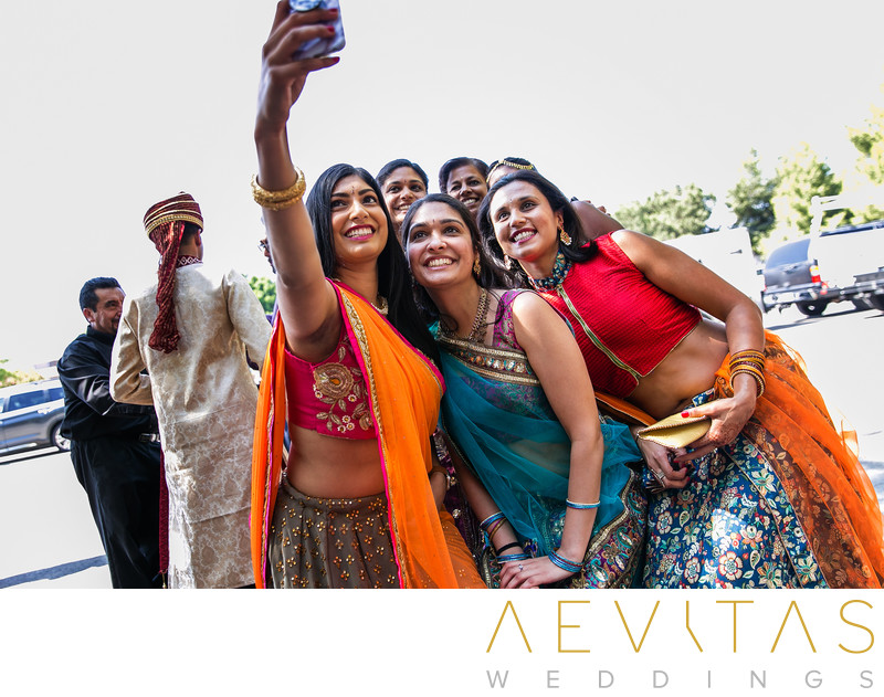 Women in saris taking selfie at Pomona Indian wedding