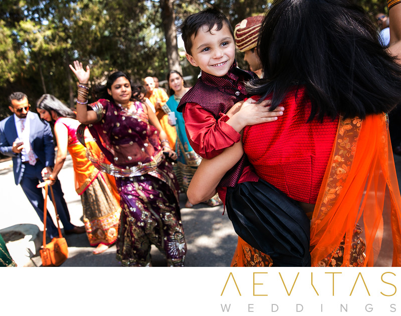 Young wedding guest with woman dancing at Indian Baraat