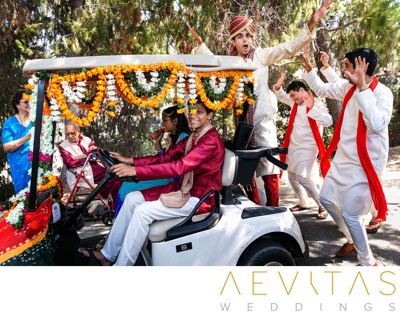 Groom on golf cart at Mountain Meadows Indian wedding