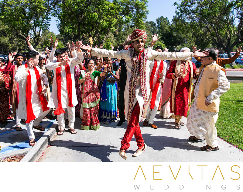 Fun photo of groom dancing at Indian Baraat ceremony
