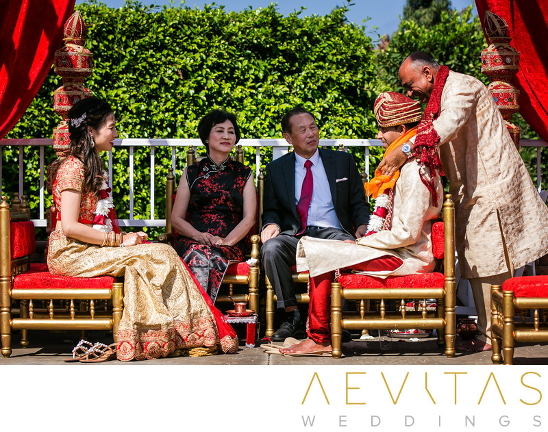 Candid moment officiant and groom at Indian wedding