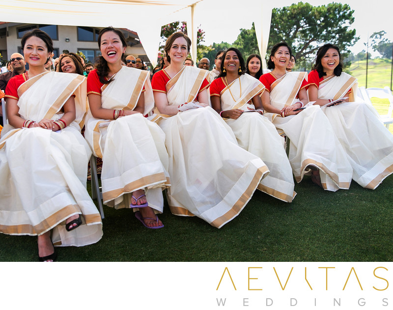 Bridesmaids smiling during Hindu wedding in Pomona