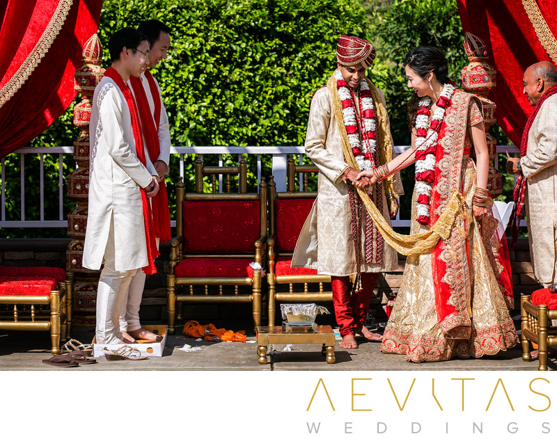 Couple walking around mandap stage at Pomona wedding