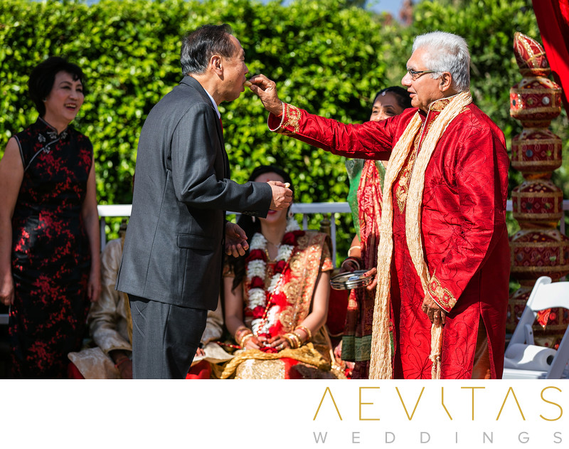 Candid moment with dads at Hindu wedding in Pomona