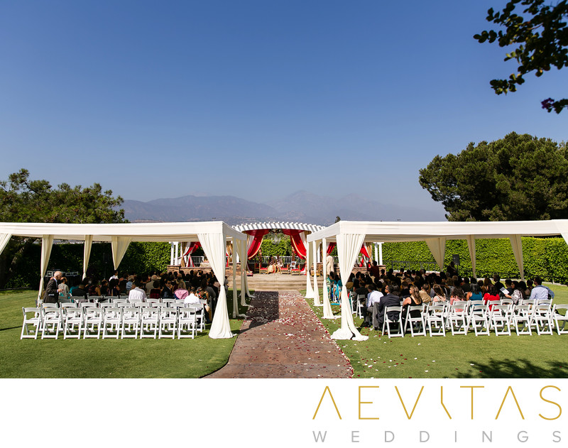 Wedding ceremony with mountains at Pomona golf course