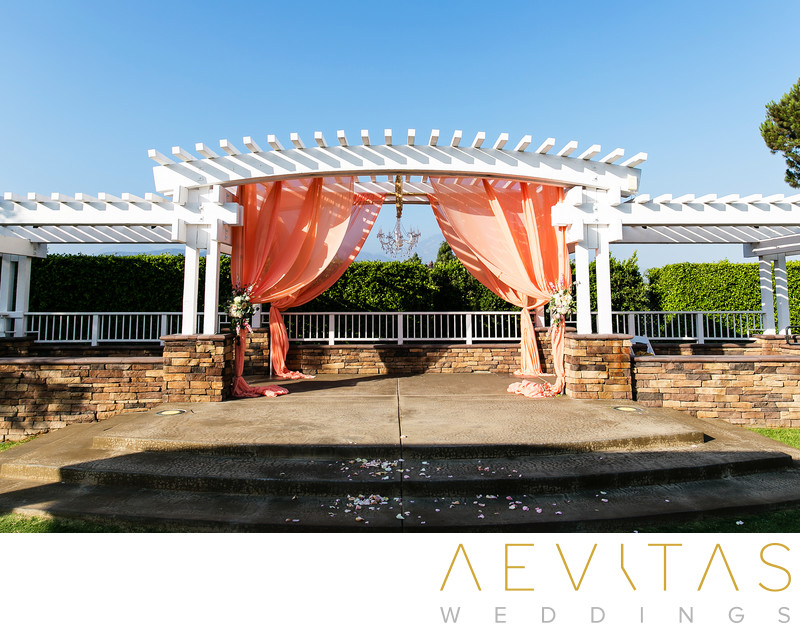 Bridal pavilion with apricot drapes at Mountain Meadows