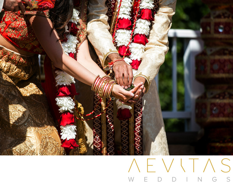 Close-up of couple's hands at Hindu wedding ceremony