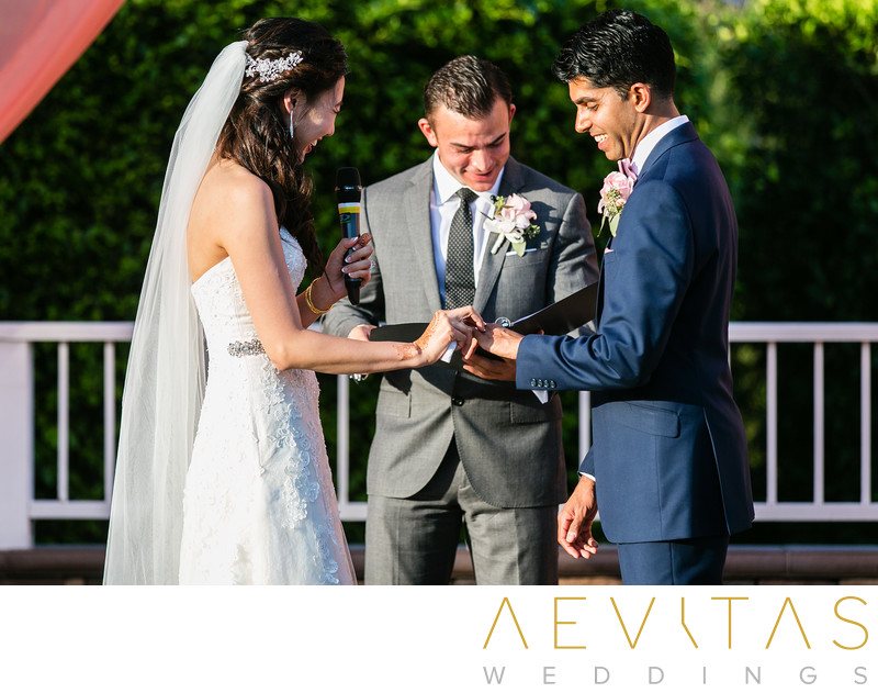 Couple ring exchange with officiant at Pomona wedding