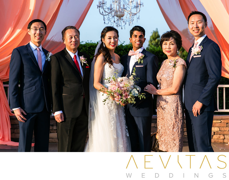 Couple portrait with bride's family Mountain Meadows