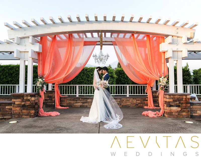 Romantic couple portrait with apricot drapes in Pomona