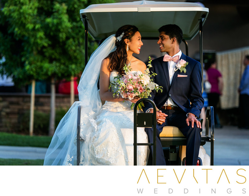 Couple in golf cart at Mountain Meadows wedding, Pomona