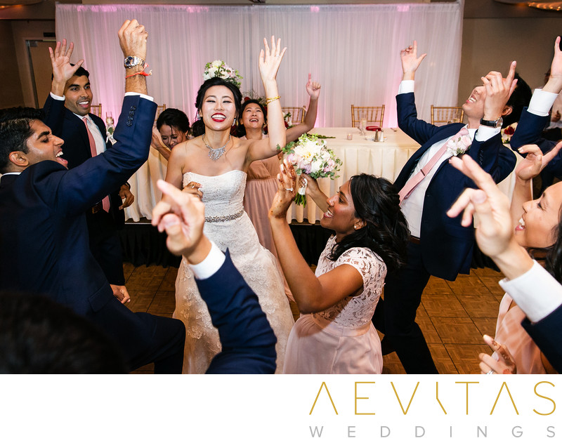 Couple dancing with bridal party at Mountain Meadows