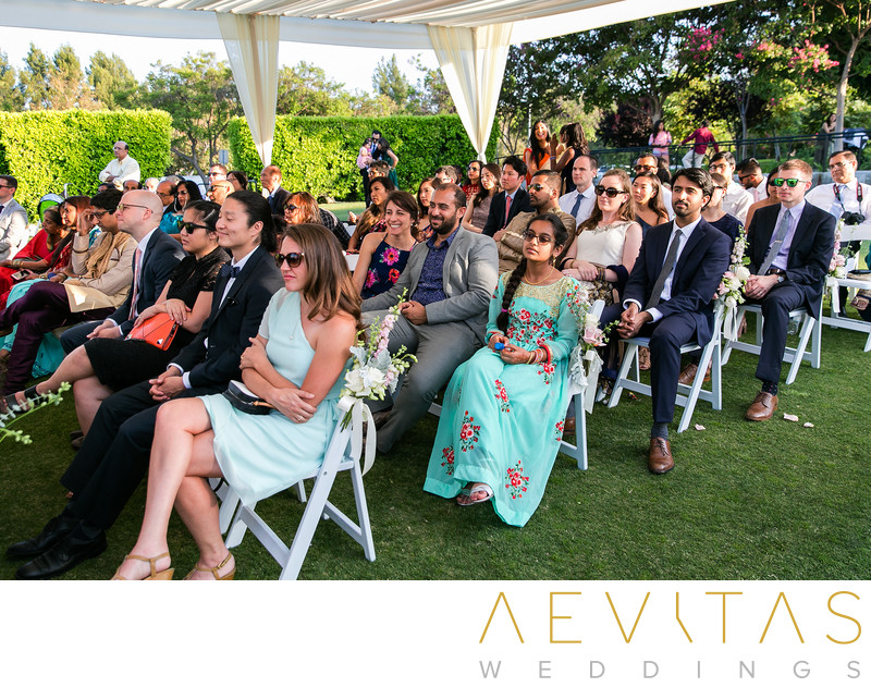 Wedding guests watching ceremony at Mountain Meadows