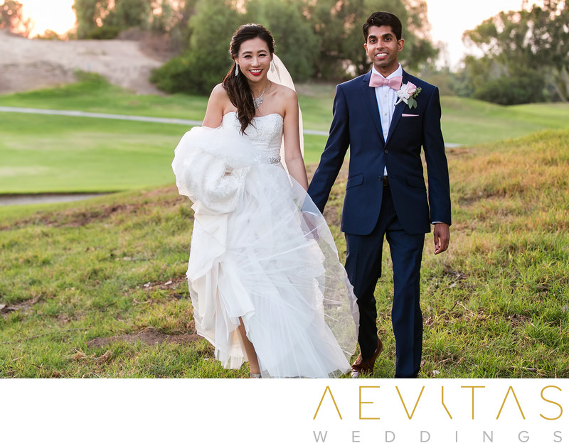 Bride and groom walking at Mountain Meadows Golf Course