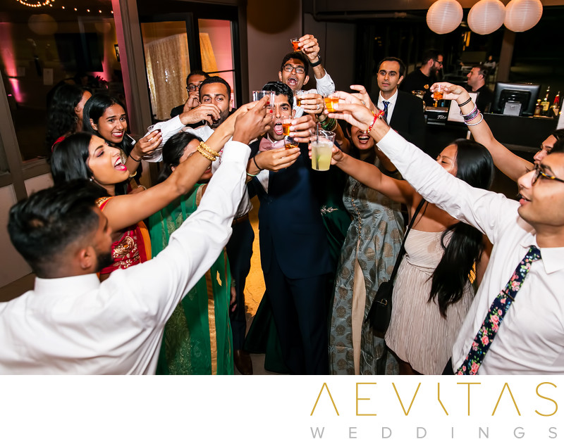 Groom toasting with guests at Pomona wedding reception