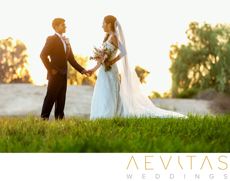 Couple holding hands at sunset Mountain Meadows wedding