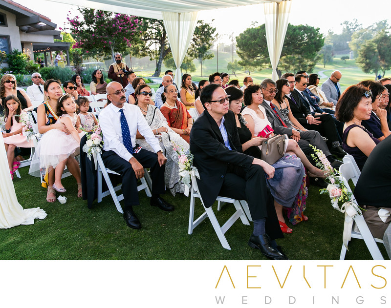 Wedding guests under pavilion at Mountain Meadows