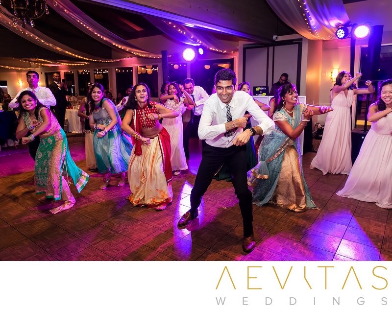 Guests and bridal party dancing at Indian reception