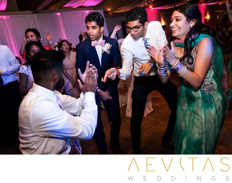 Playful moment on dance floor at Pomona reception