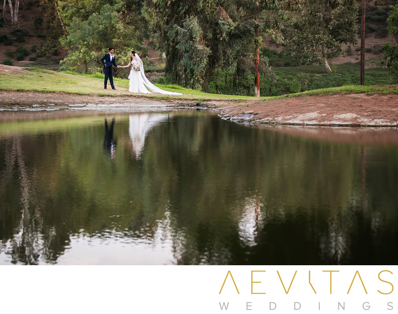Couple portrait with lake at Mountain Meadows in Pomona