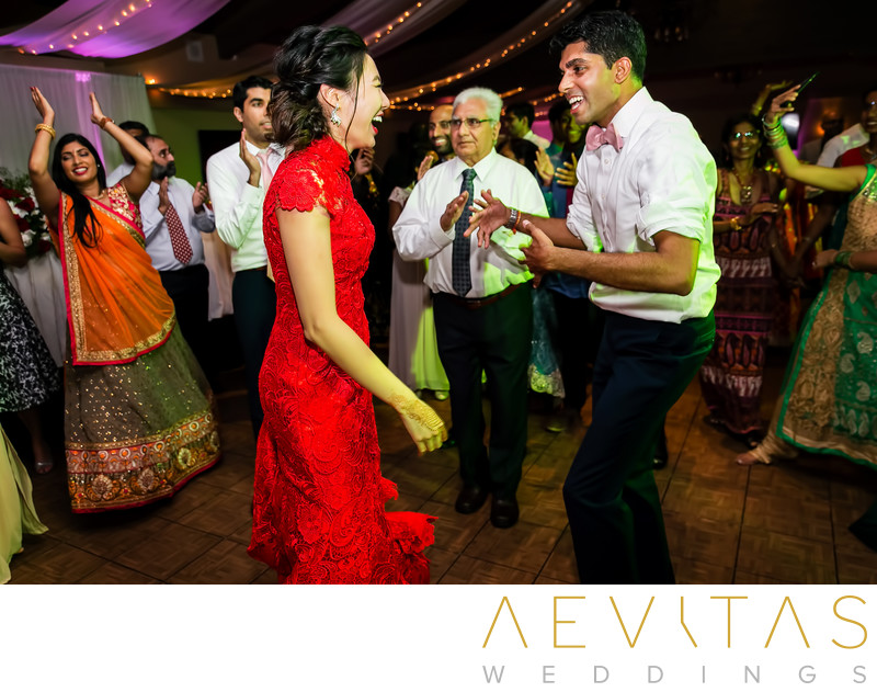 Bride and groom dancing at multicultural wedding Pomona