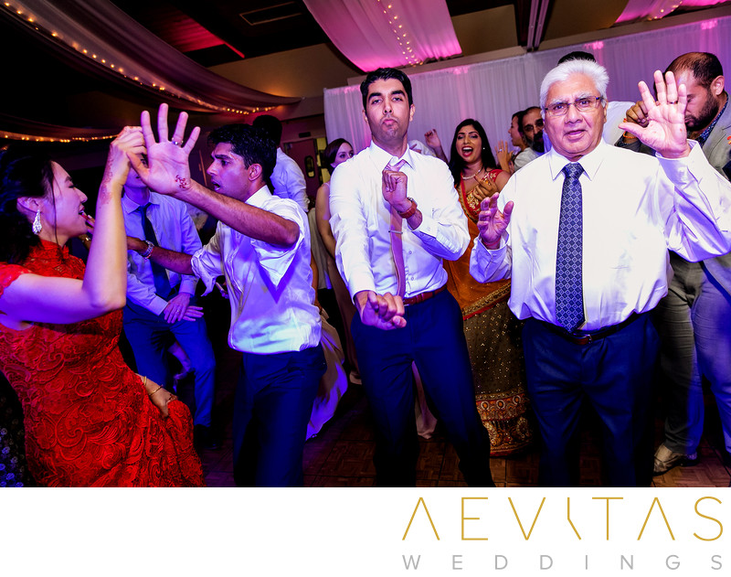Couple dancing with groom's family at Pomona wedding