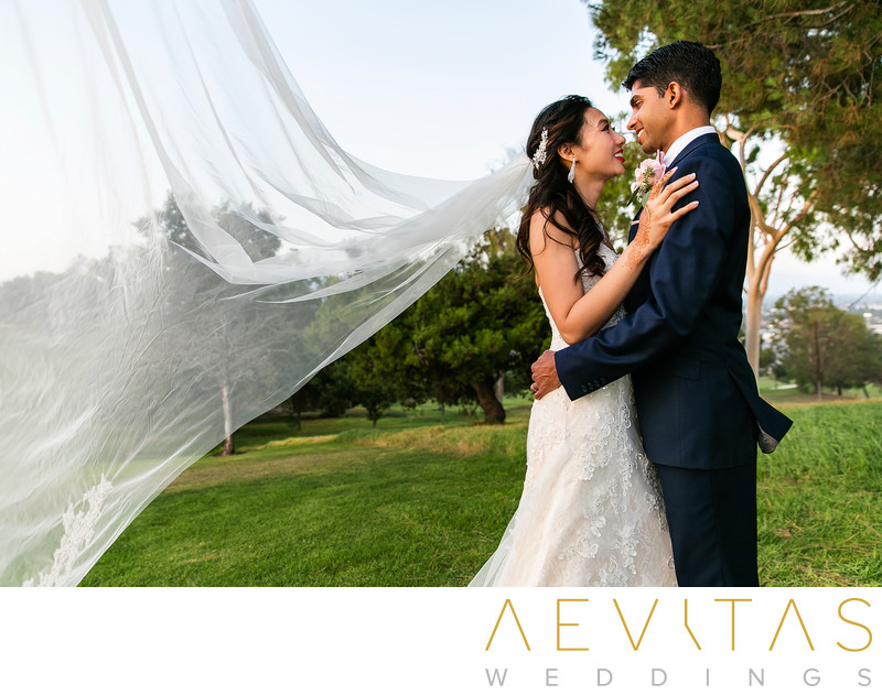 Couple portrait with flying veil by Pomona photographer