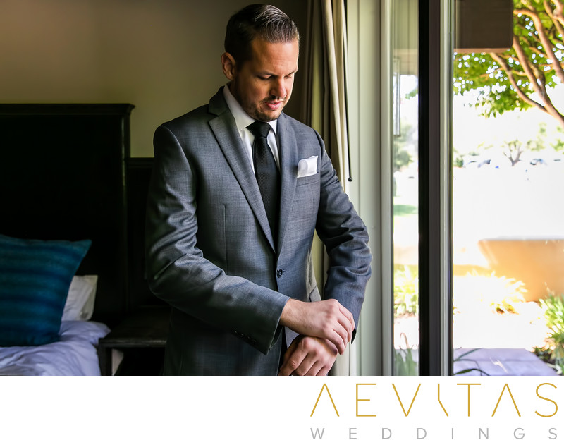 Groom portrait adjusting suit jacket in Kenwood