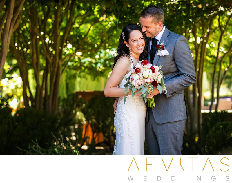 Couple smiling with bouquet at Landmark Vineyards