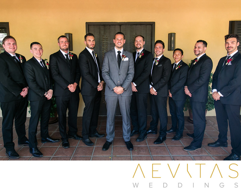 Groom portrait with groomsmen at Landmark Vineyards
